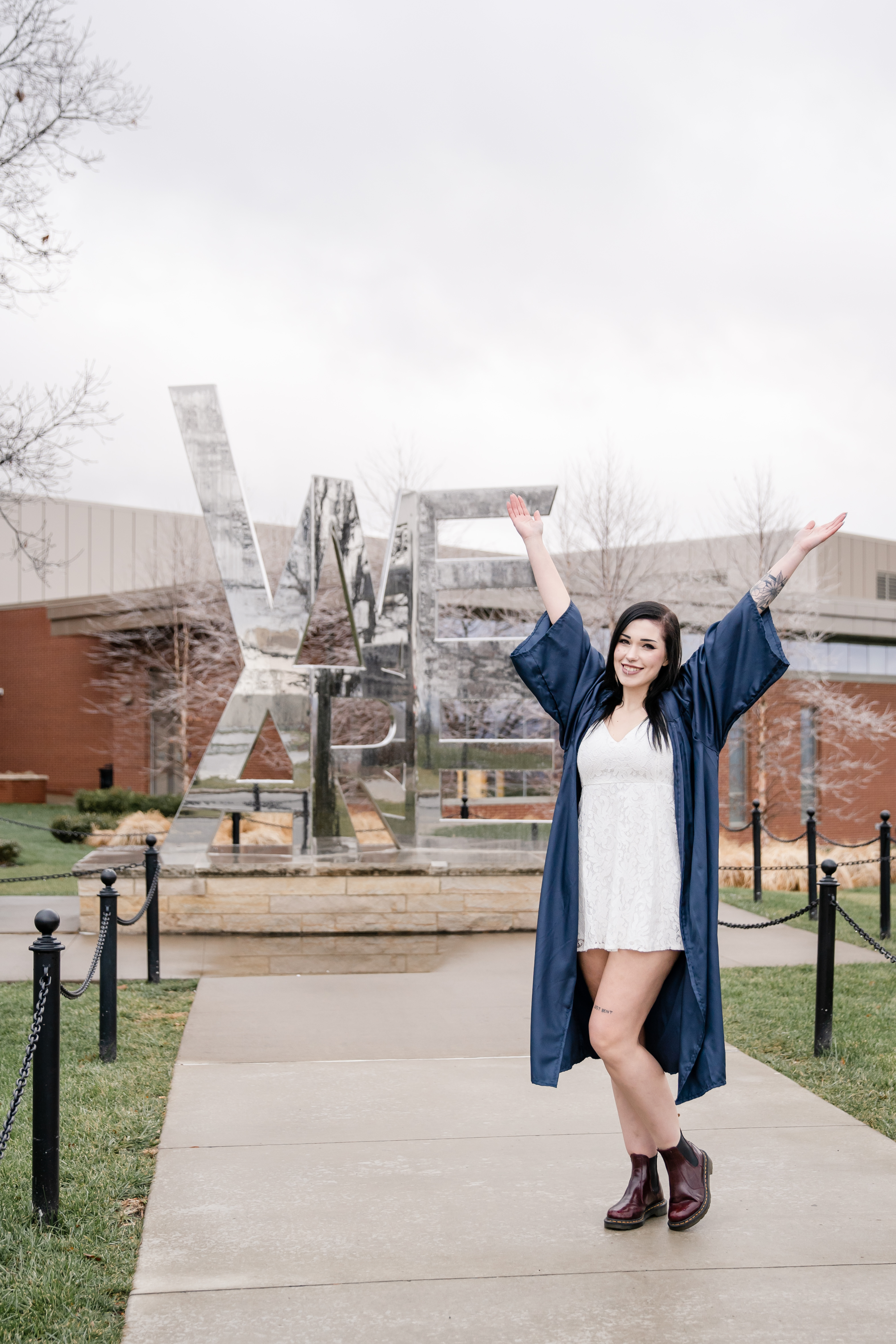 Penn State graduate at We Are sign