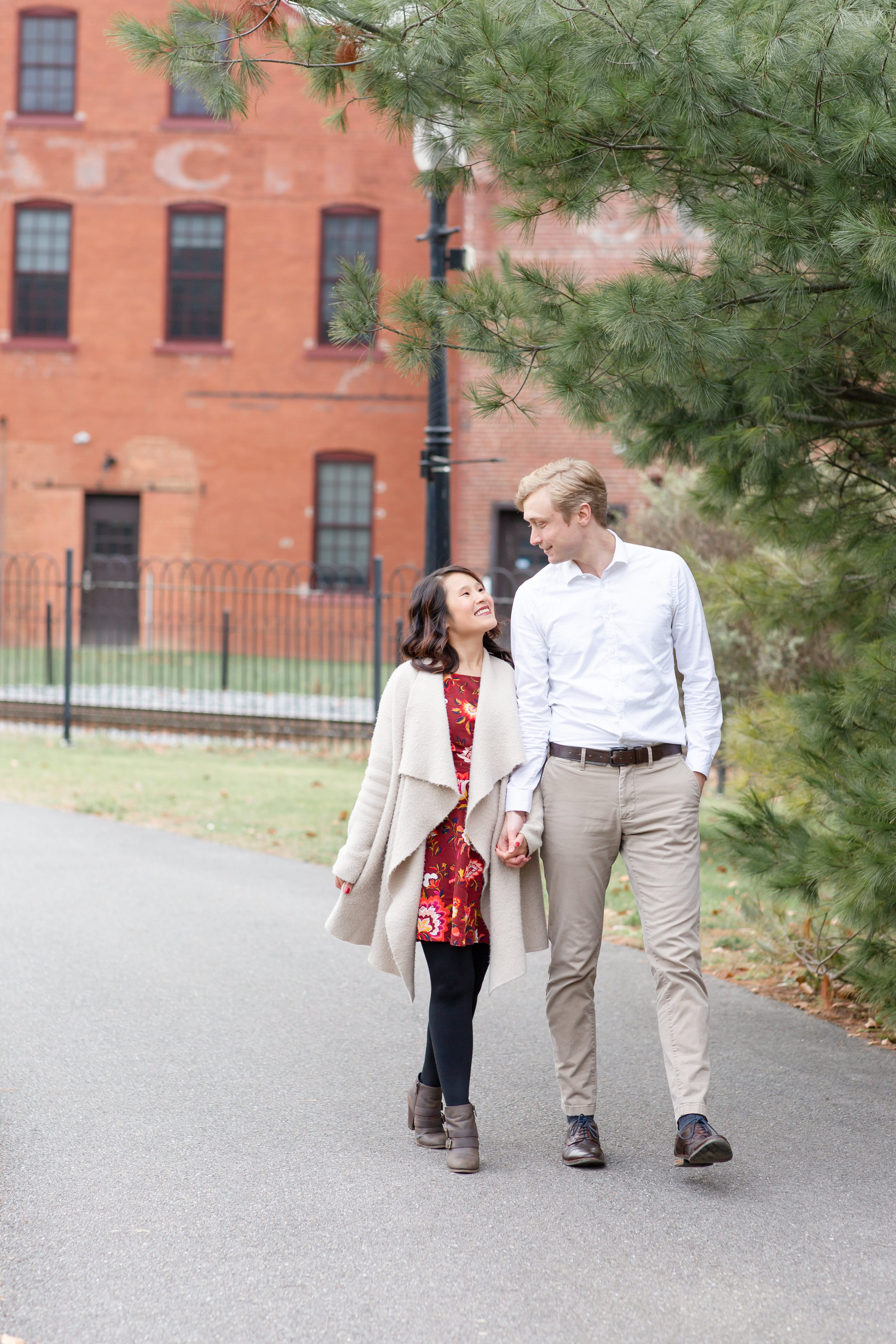 Engaged couple strolling through Talleyrand Park in Bellefonte
