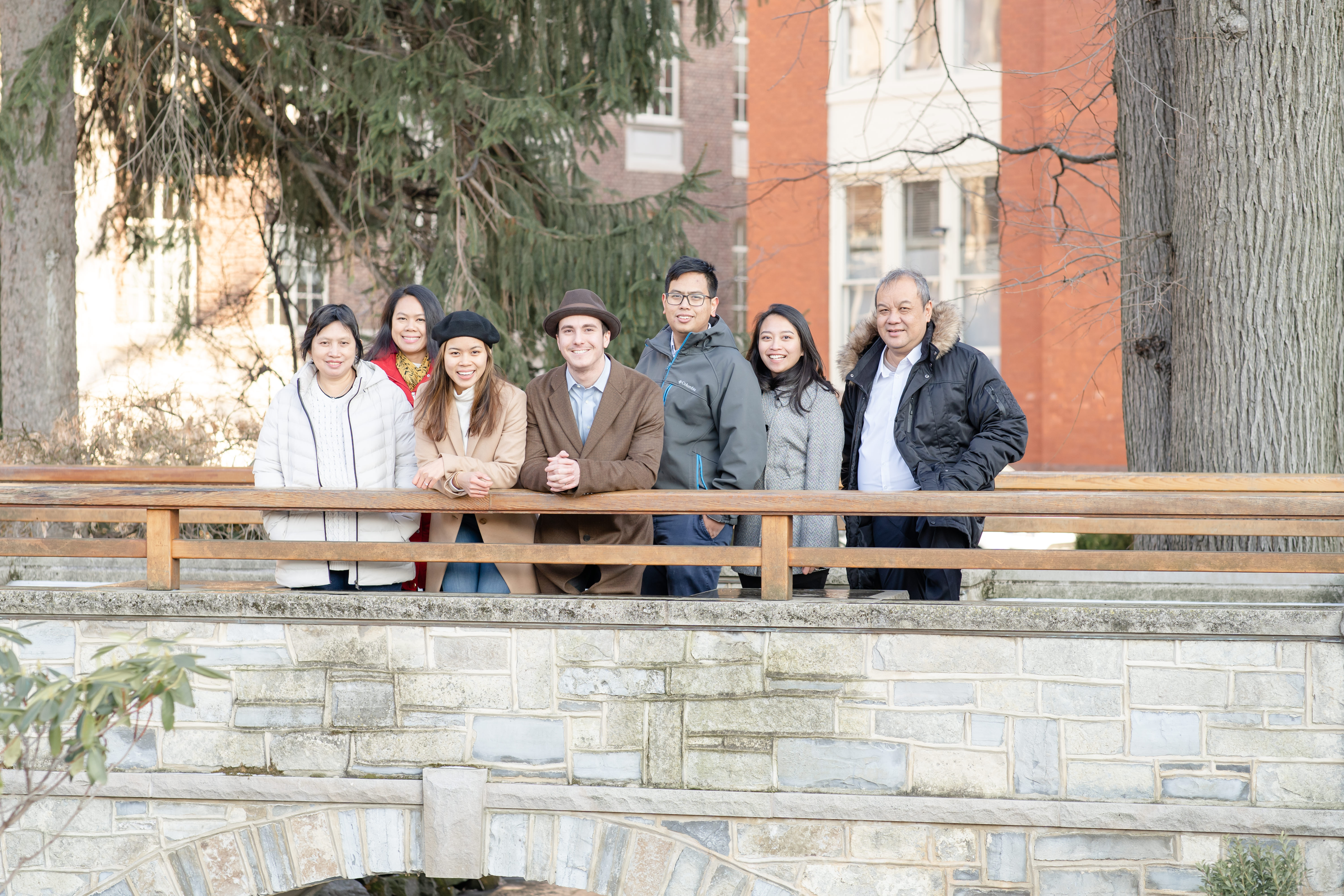 Joyous family celebration at Hintz Alumni Garden bridge