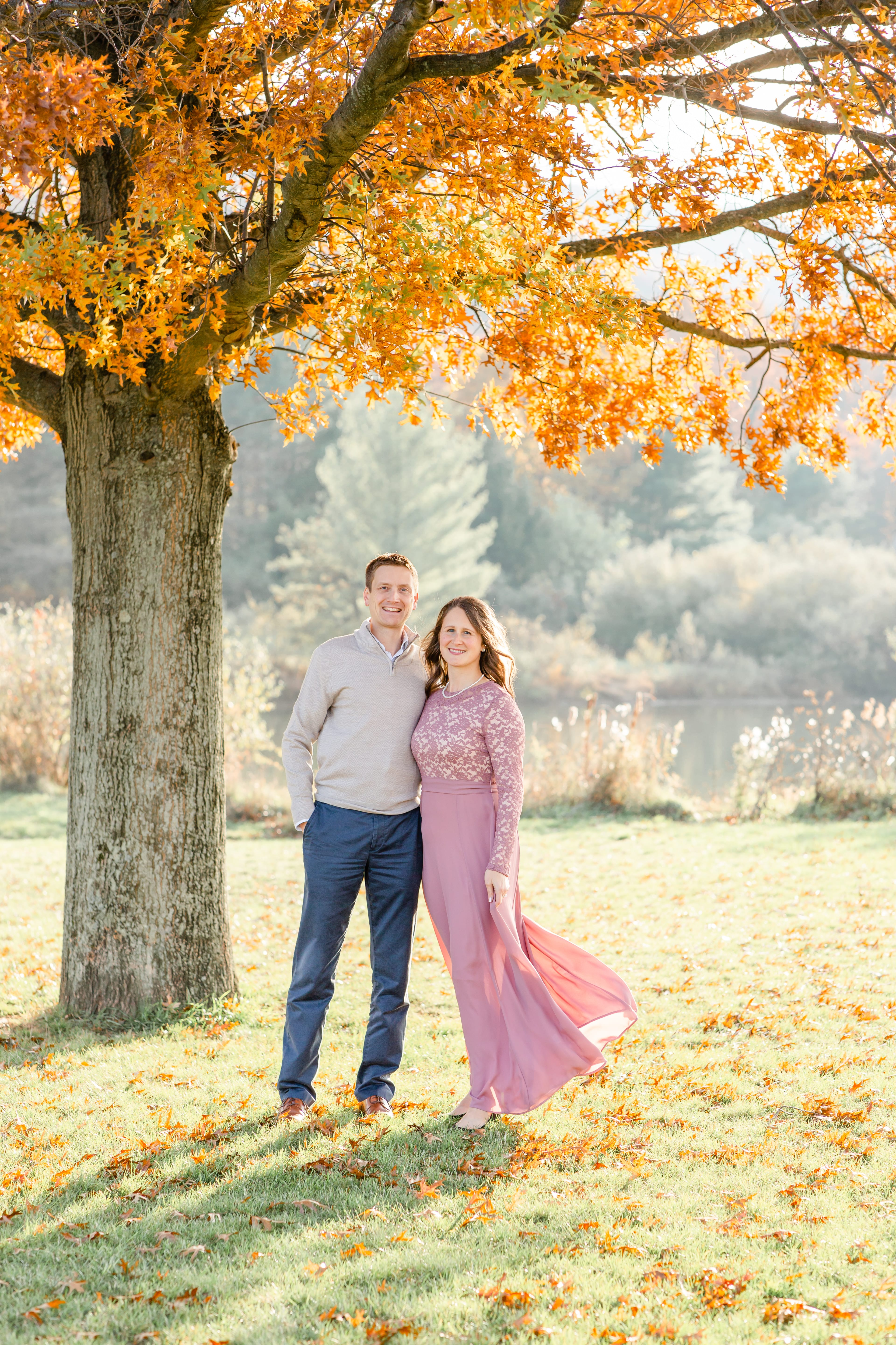 family fall photo in State College; husband and wife; red tree