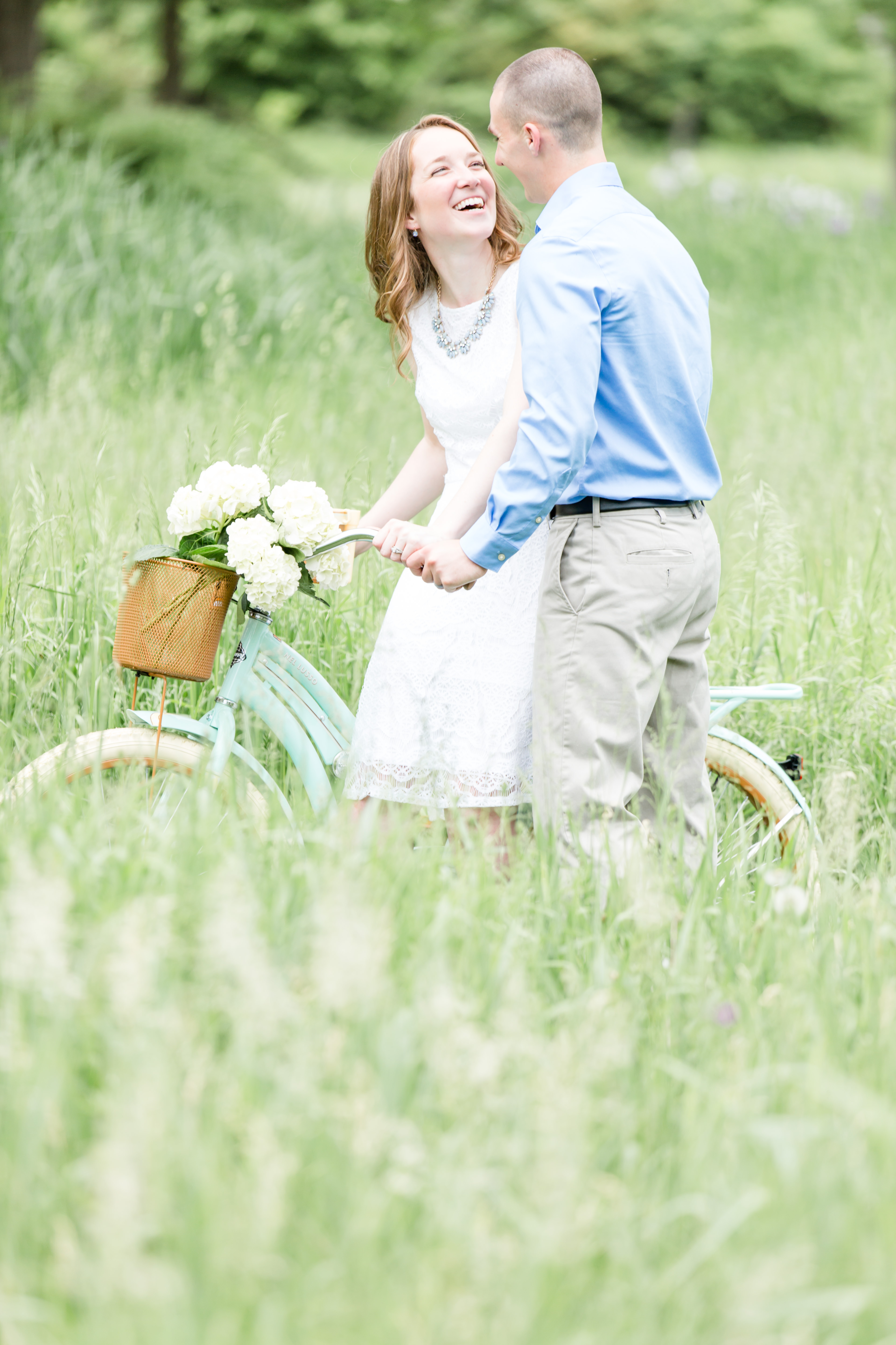 Engagement photo at Millbrook Marsh State College with mint bike and hydrangeas