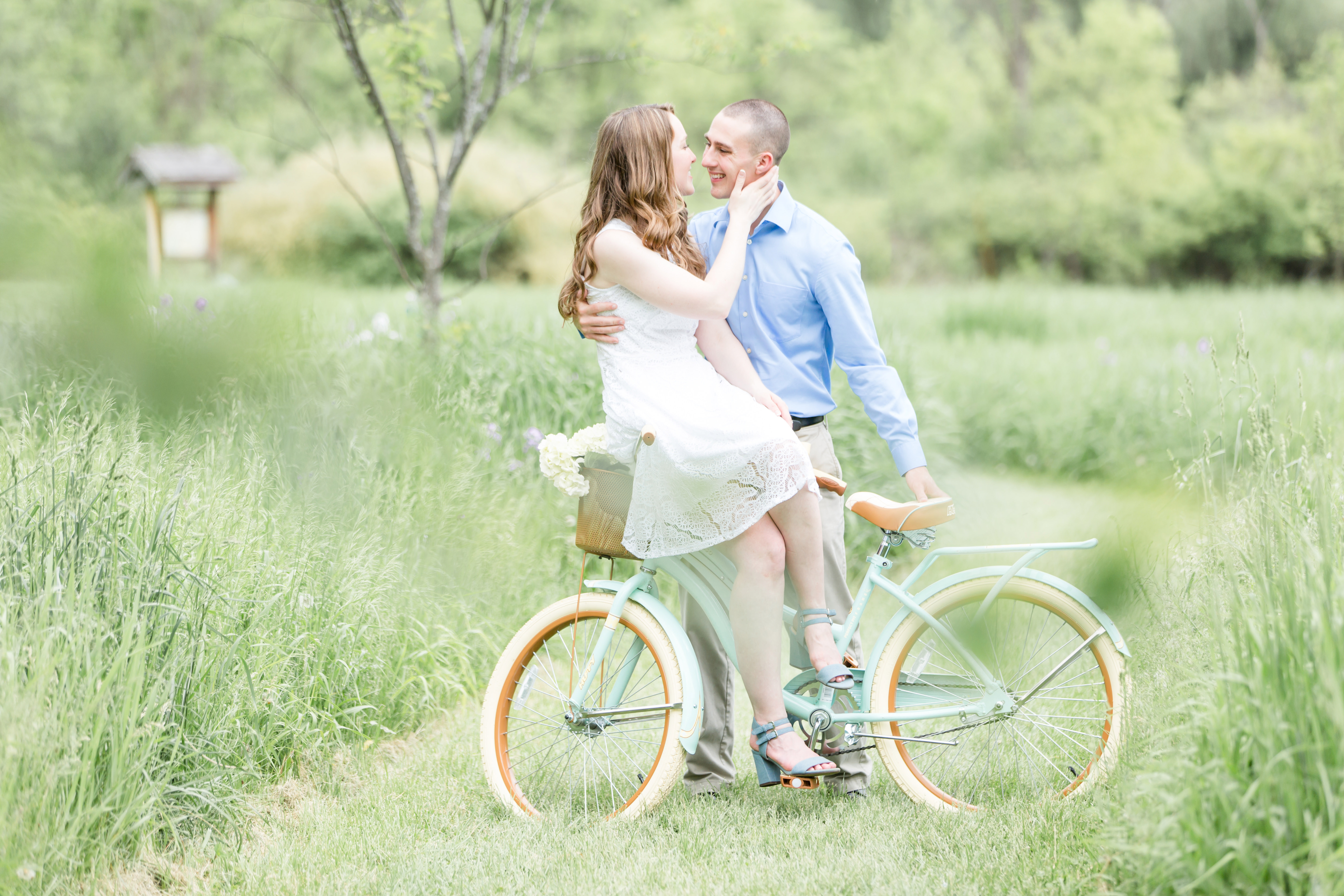 Engagement photo at Millbrook Marsh State College with mint bike