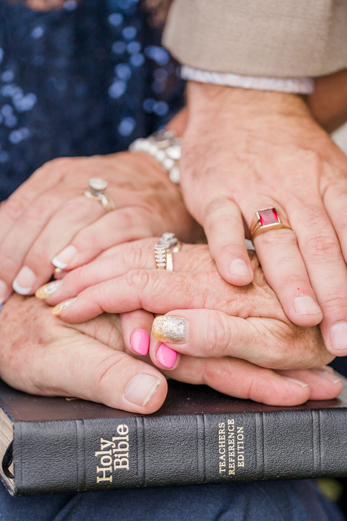 Generational hands portrait at Penn State arboretum