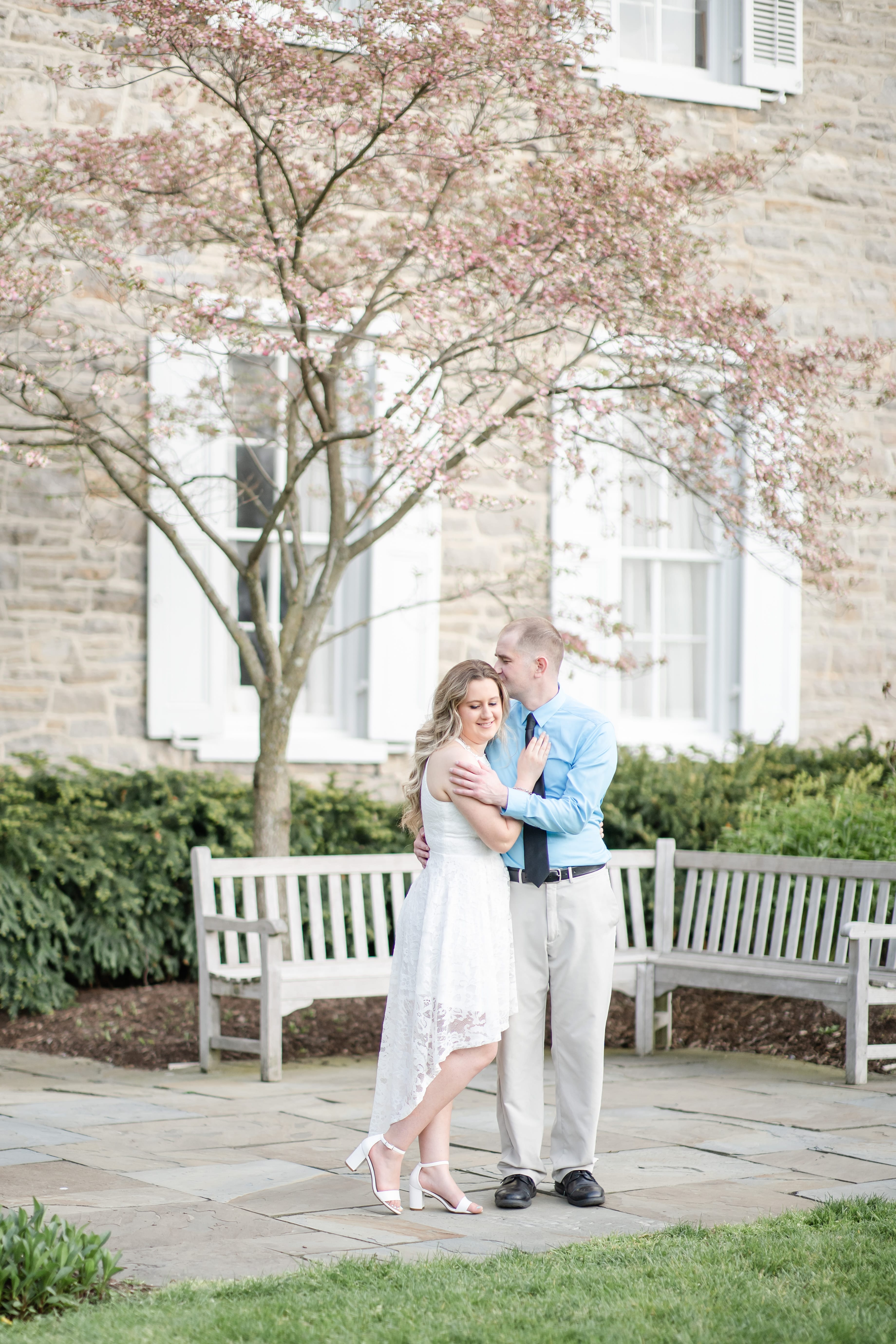 Engagement photo at Penn State Hintz Alumni Garden with flowering tree