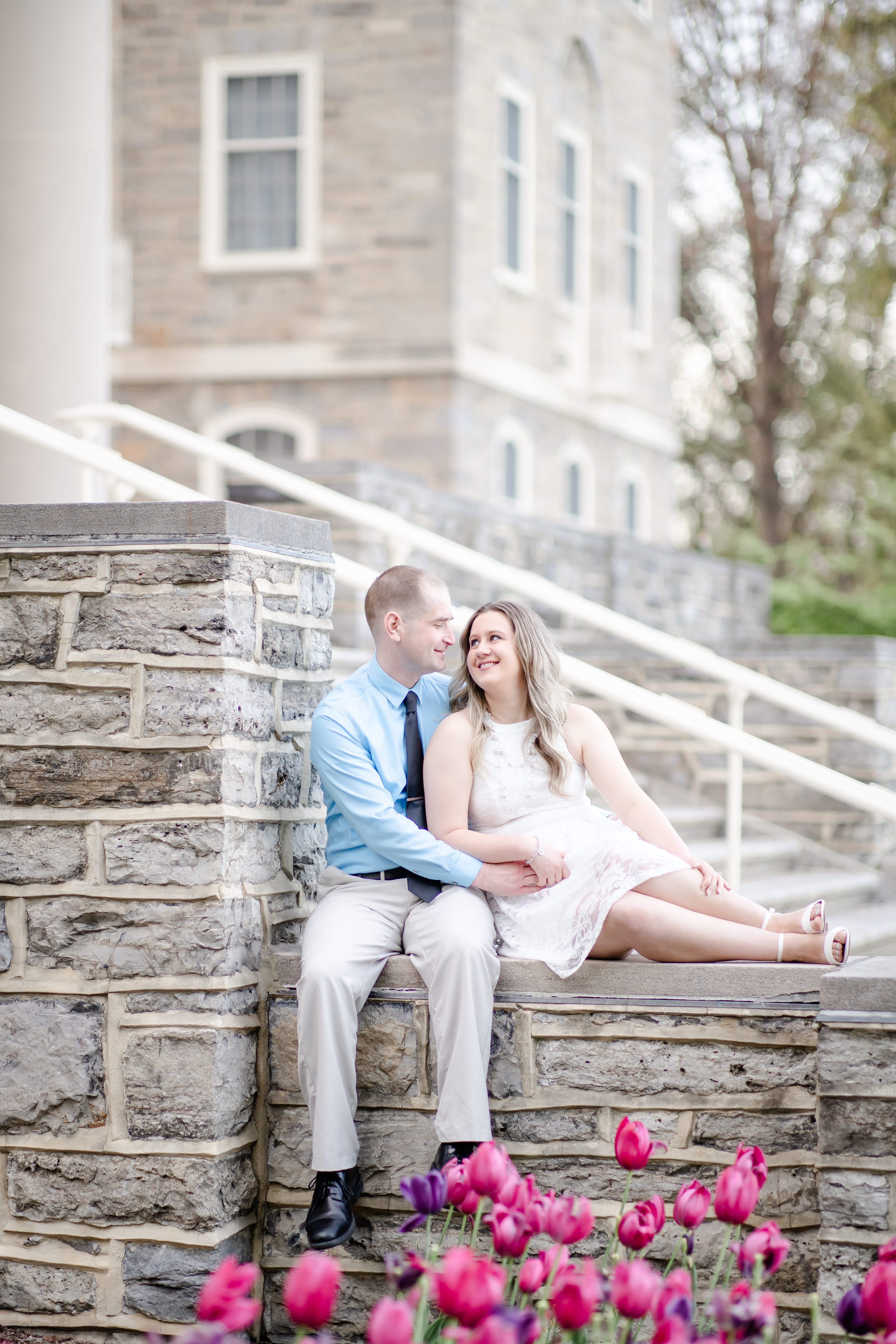 Engagement photo at Penn State Old Main steps during springtime