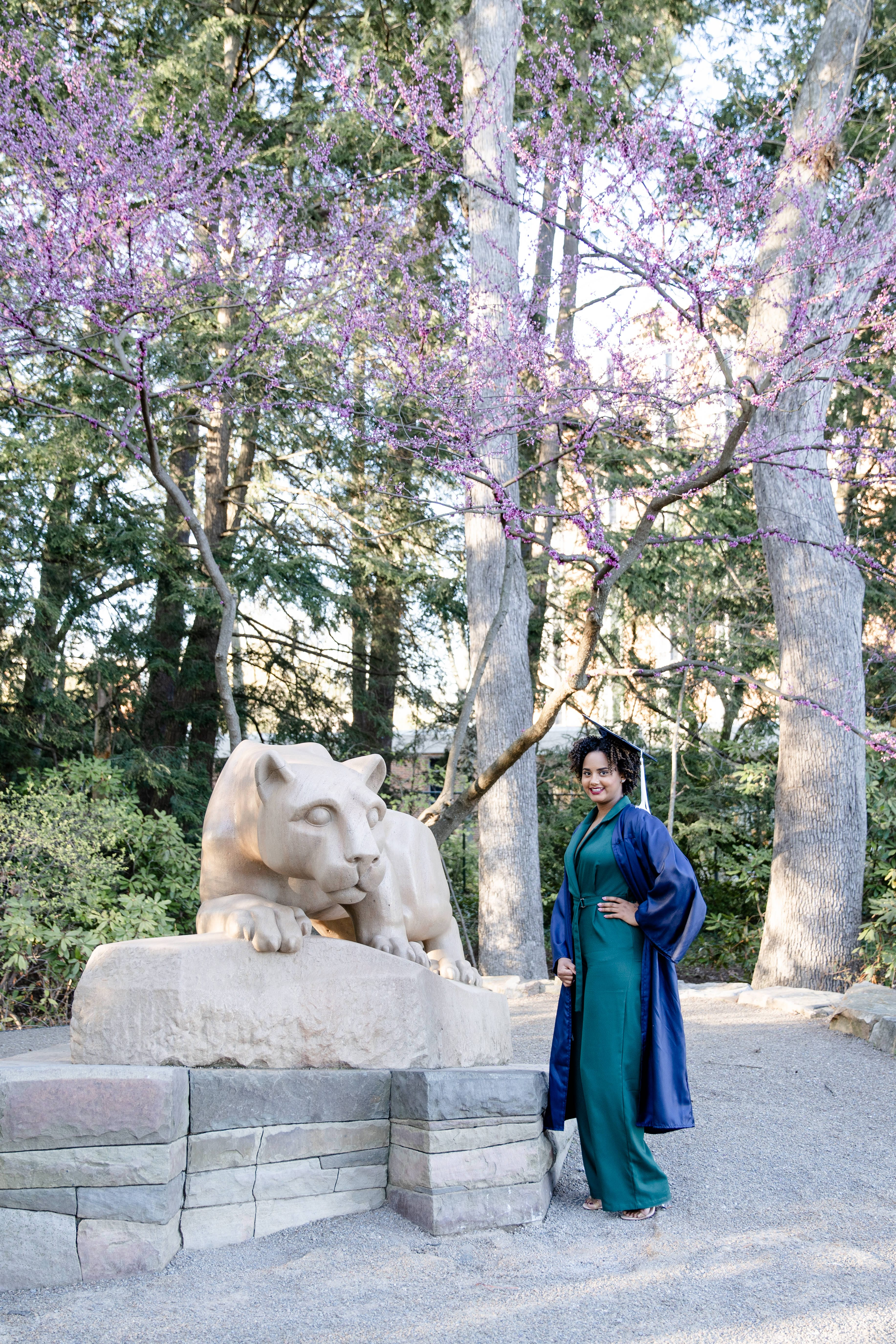 Class of 2020 Penn State graduate at Nittany lion shrine