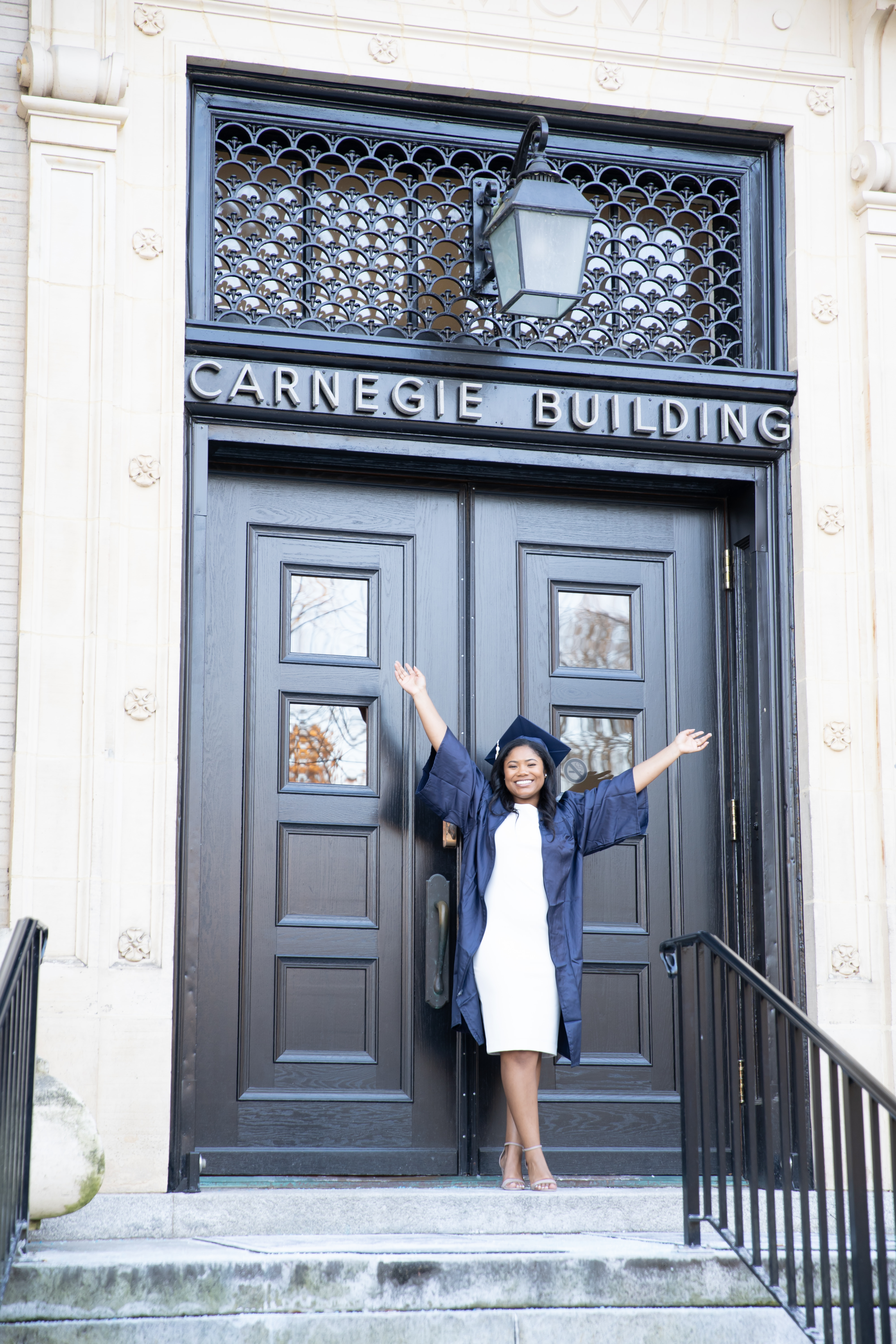 Penn State graduate in front of Carnegie Building
