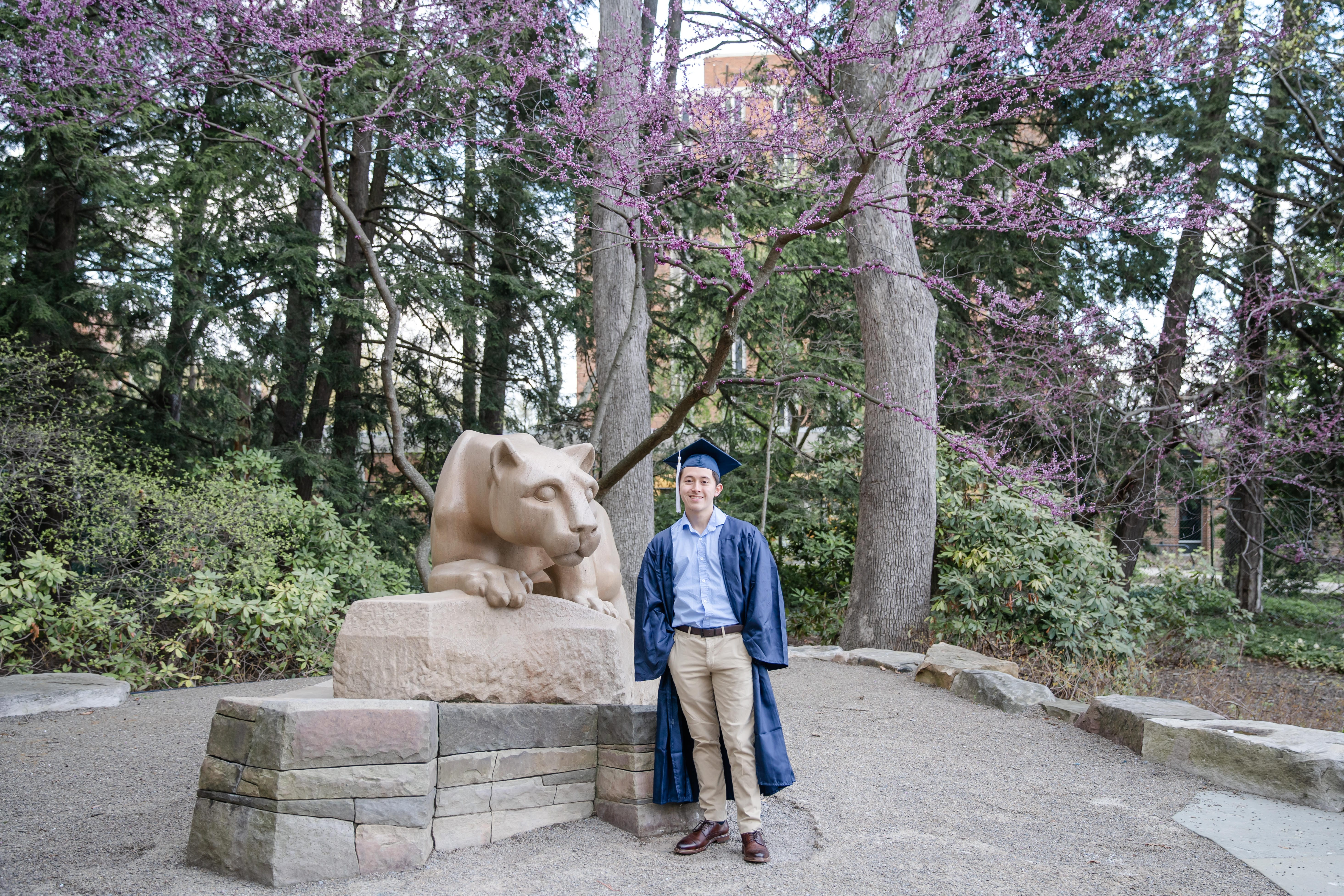Class of 2020 graduate at Penn State lion shrine