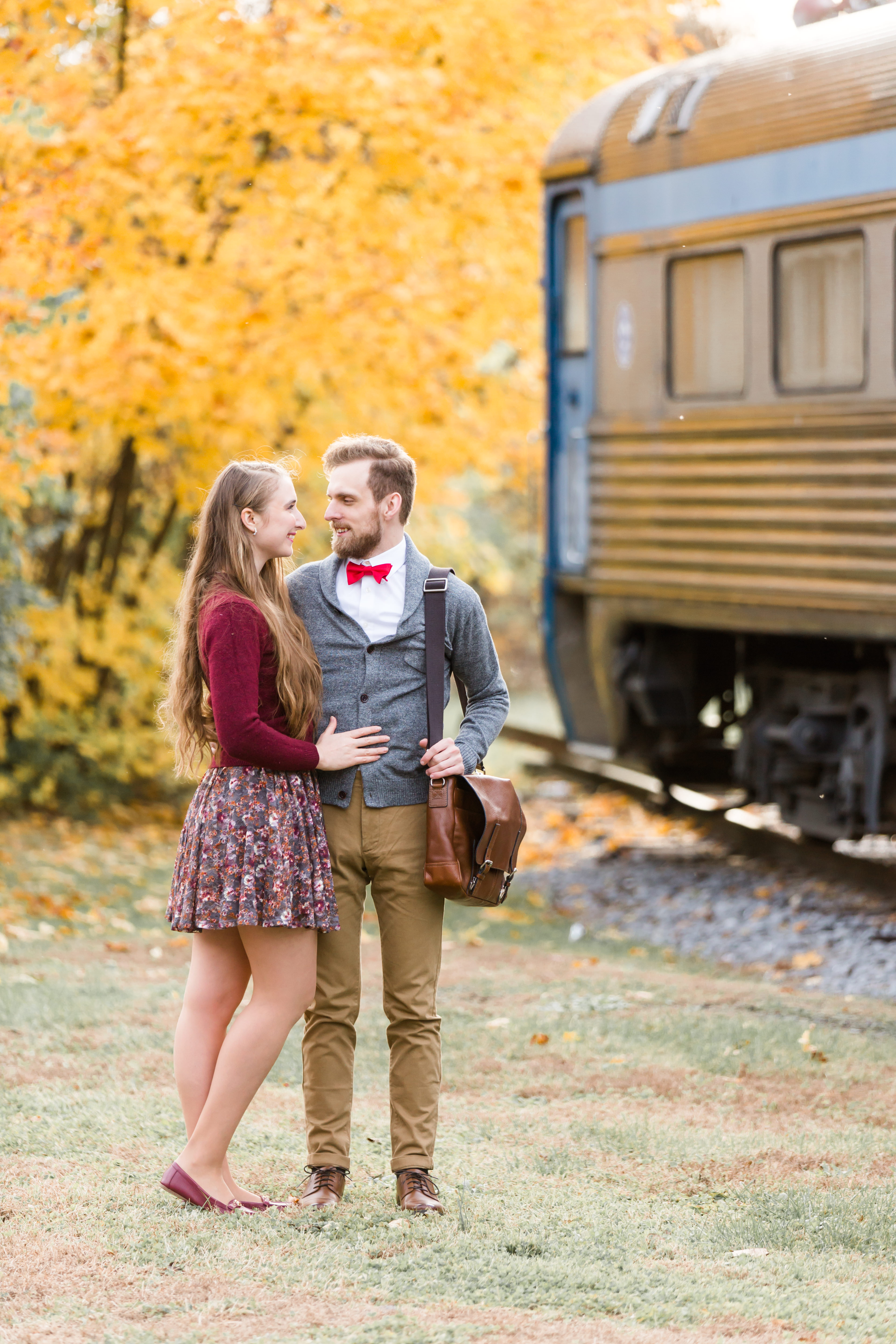 Fall engagement photos at Talleyrand Park in Victorian Bellefonte central Pennsylvania featuring inactive train railroad track