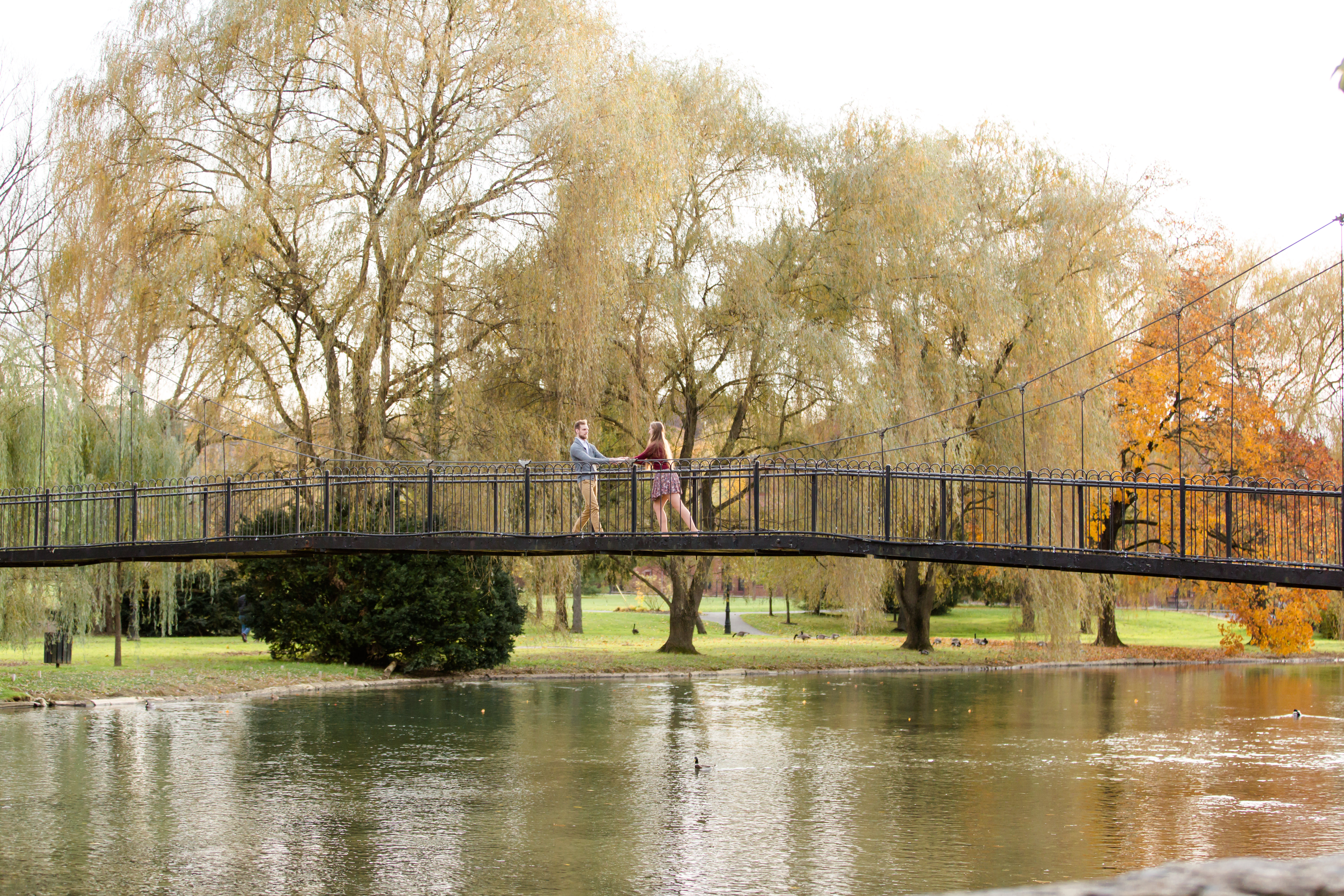 Fall engagement photos at Talleyrand Park in Victorian Bellefonte central Pennsylvania featuring the bridge