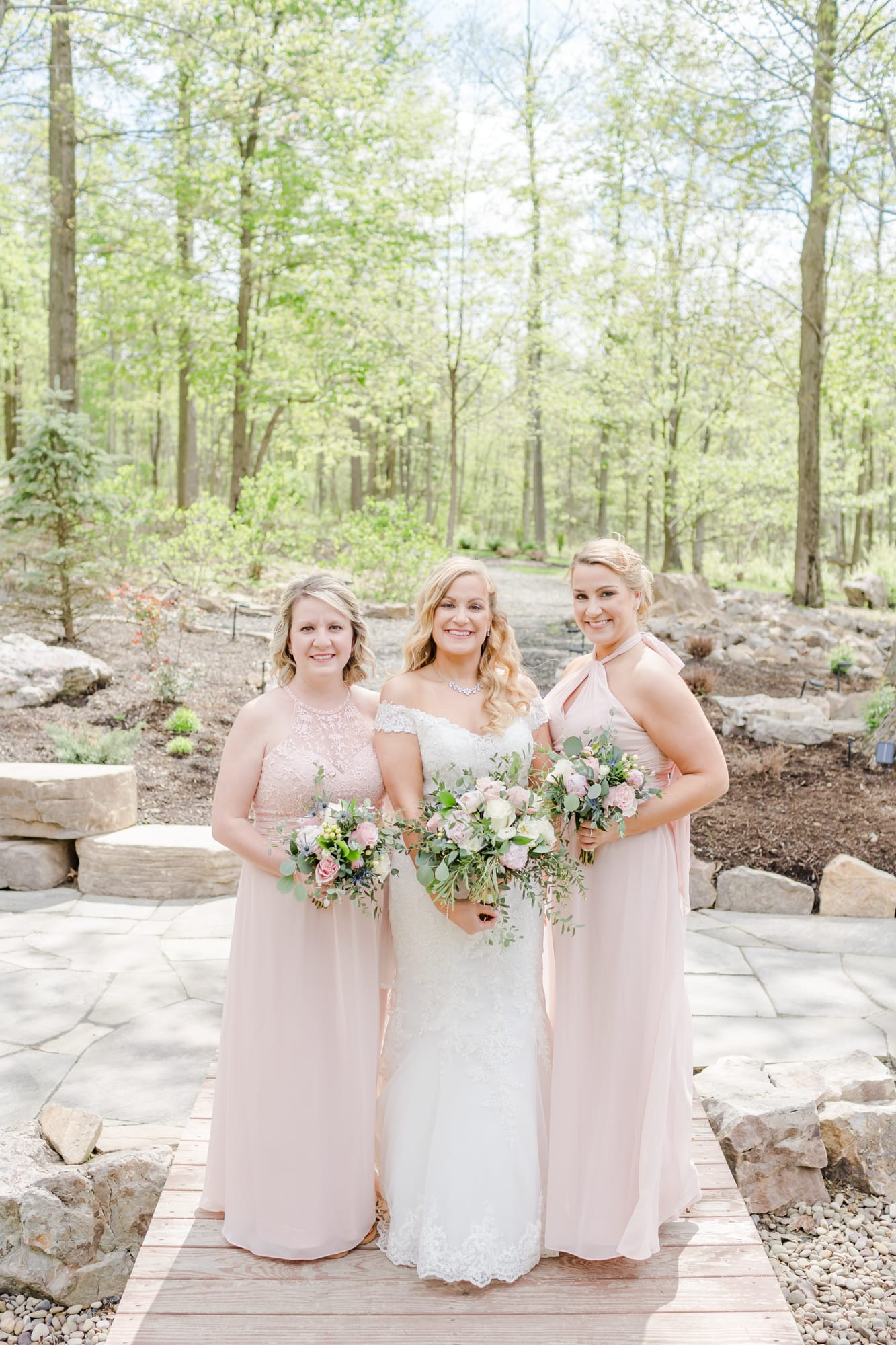 Bride and sisters at Rolling Rails Lodge wedding