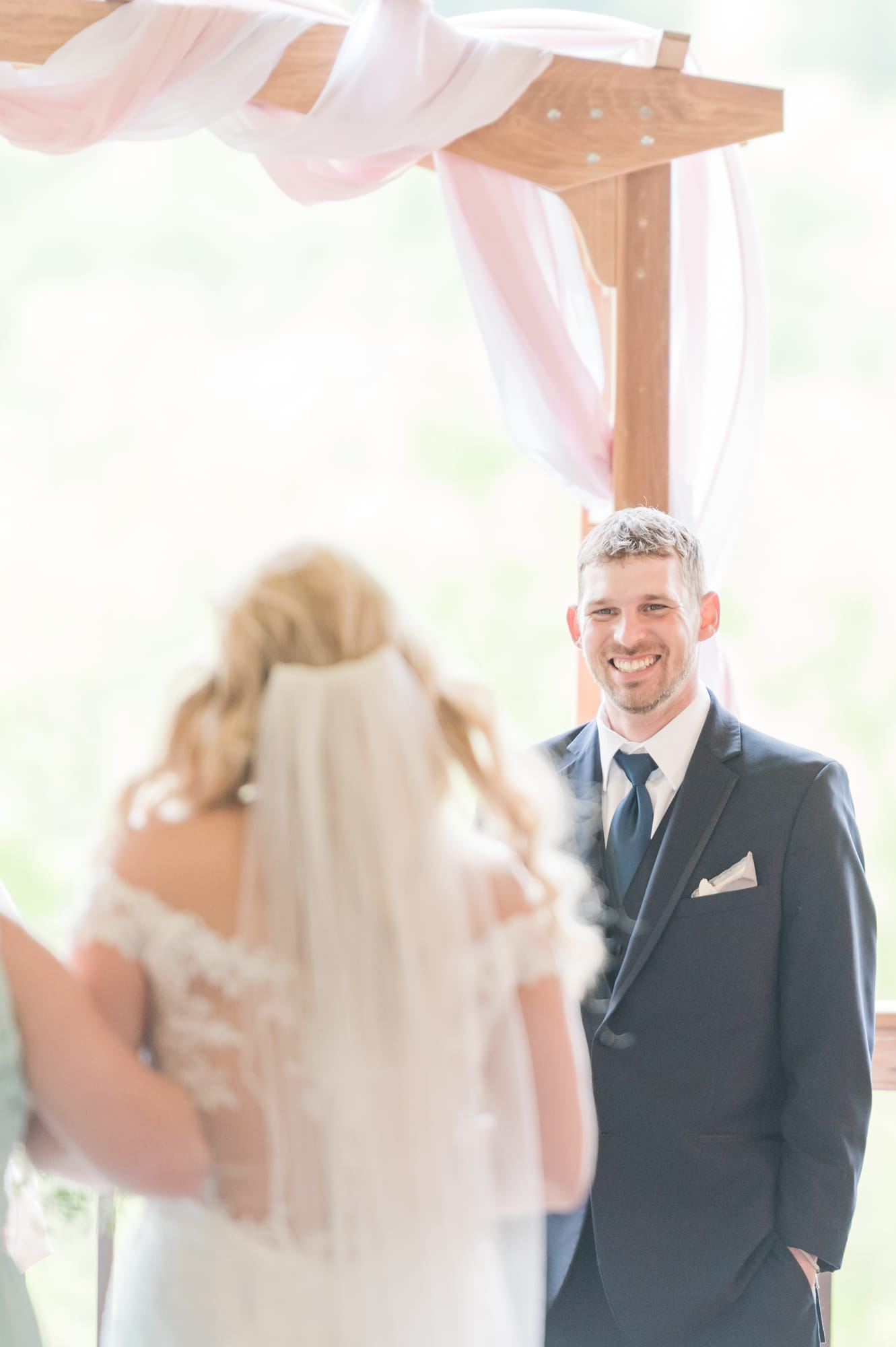 Groom seeing bride for the first time at Rolling Rails Lodge wedding ceremony
