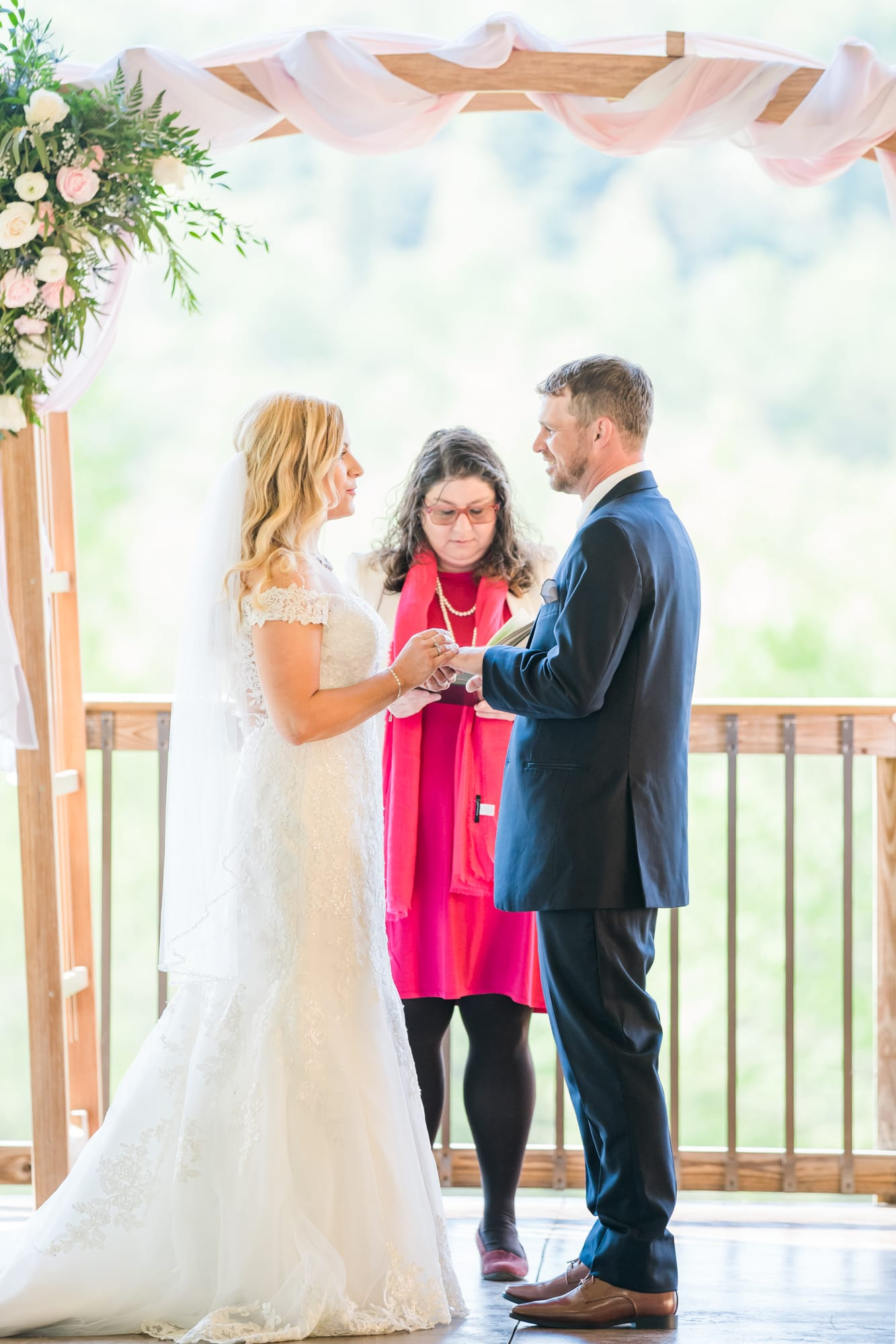 Ring exchange at Rolling Rails Lodge wedding ceremony