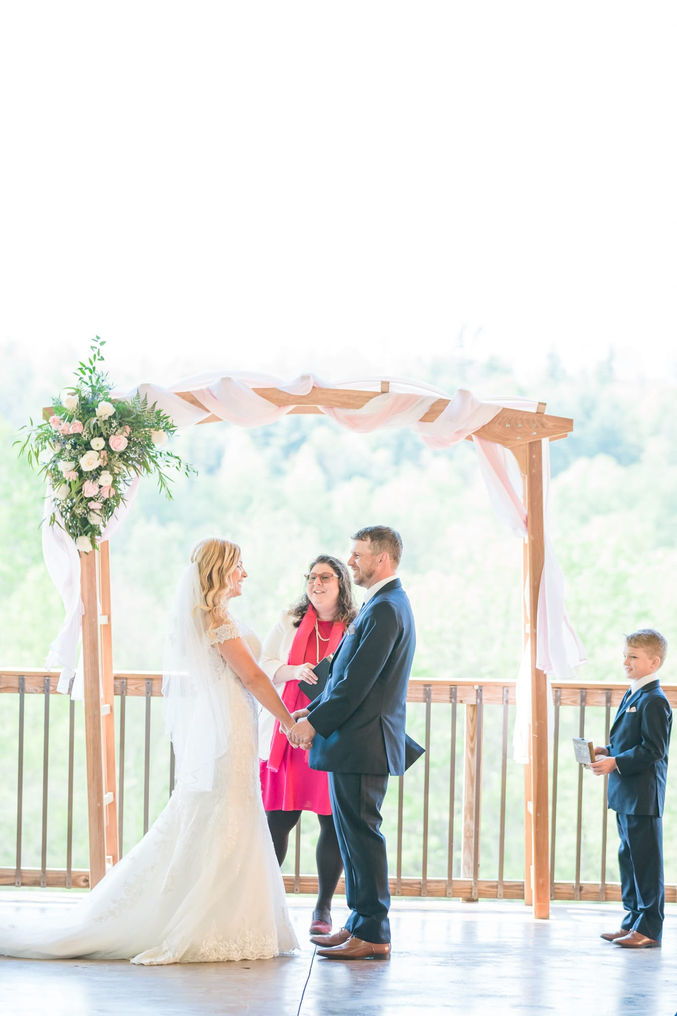 Vow exchange at Rolling Rails Lodge wedding ceremony