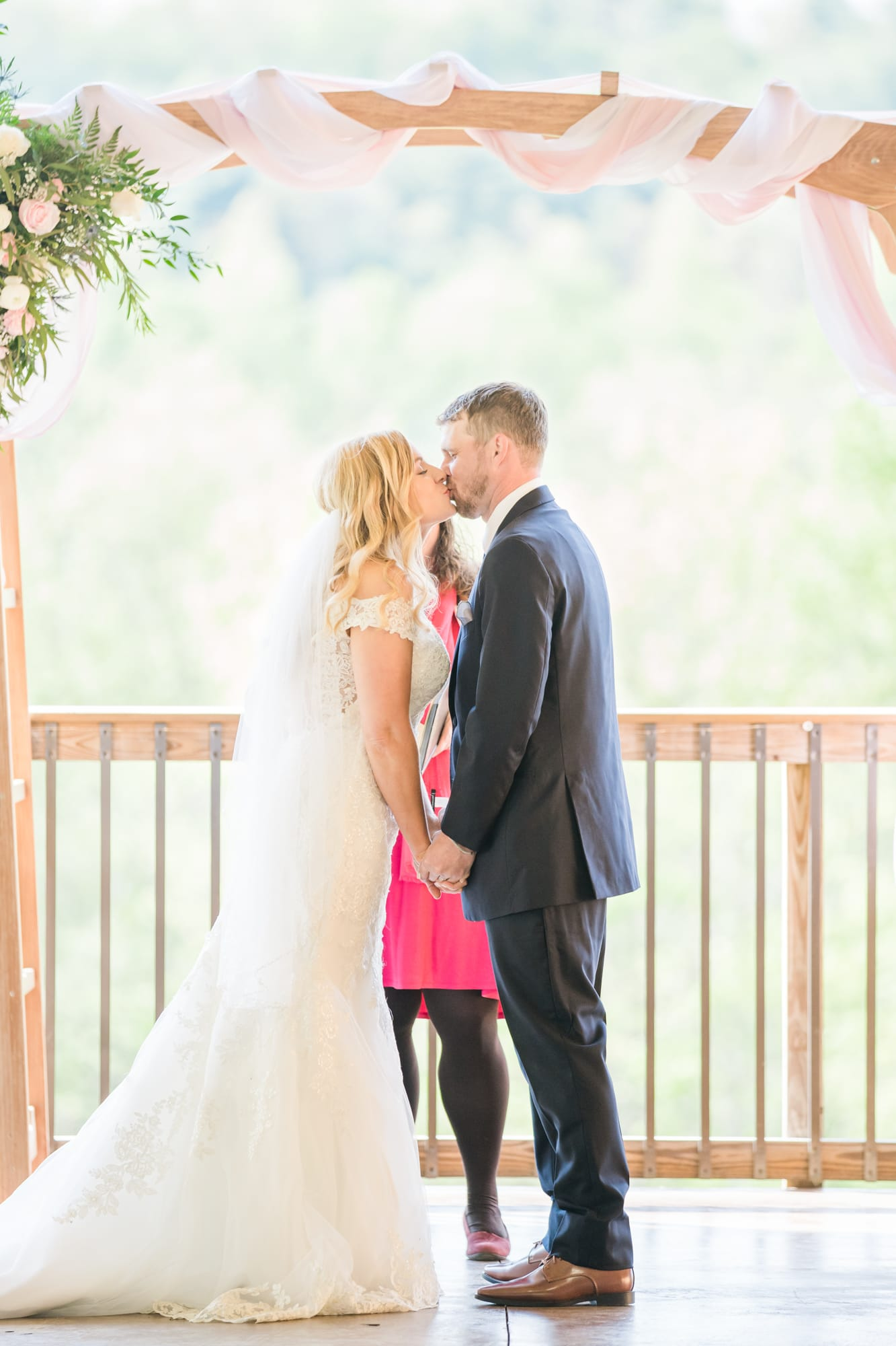 First kiss at Rolling Rails Lodge wedding ceremony