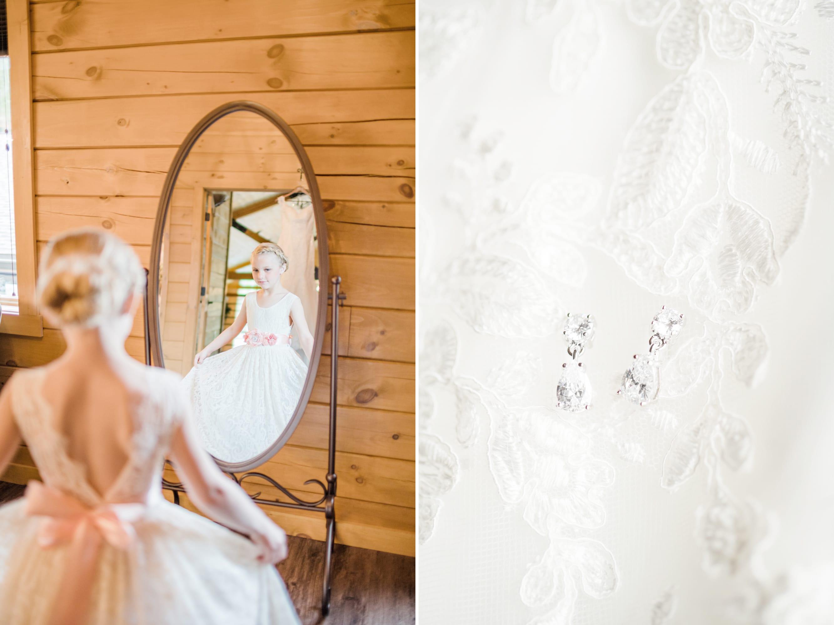 Flower girl admiring herself at Rolling Rails Lodge wedding
