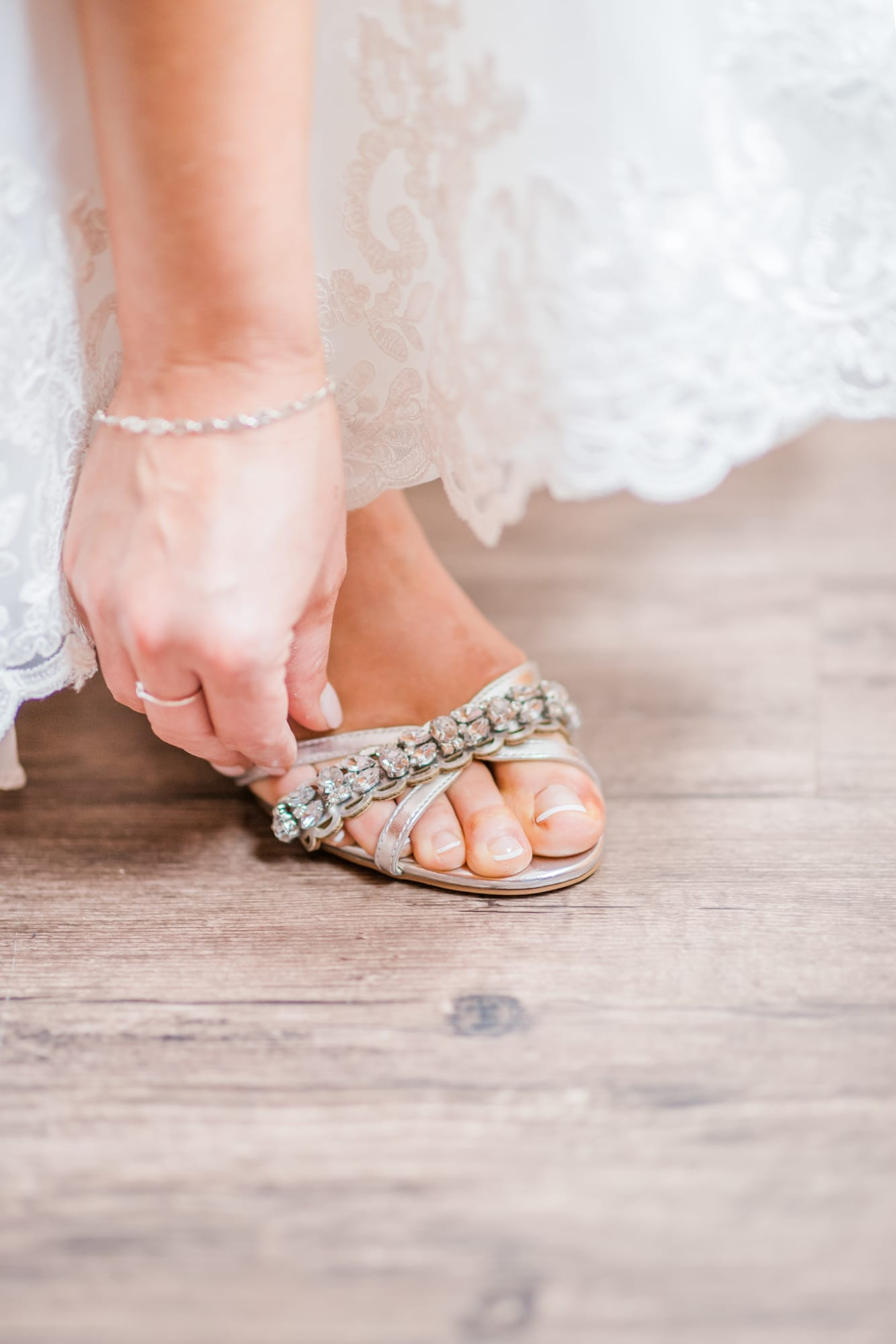 Bride putting on shoes at Rolling Rails Lodge wedding