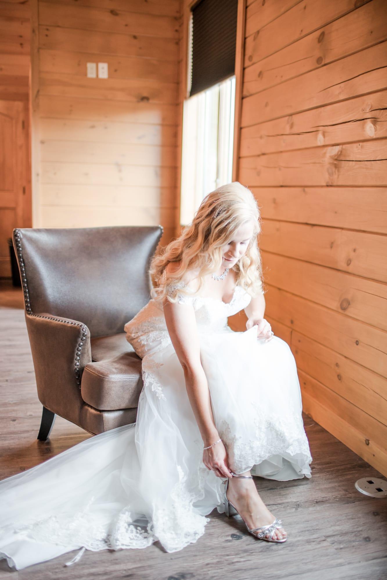 Bride getting ready at Rolling Rails Lodge wedding