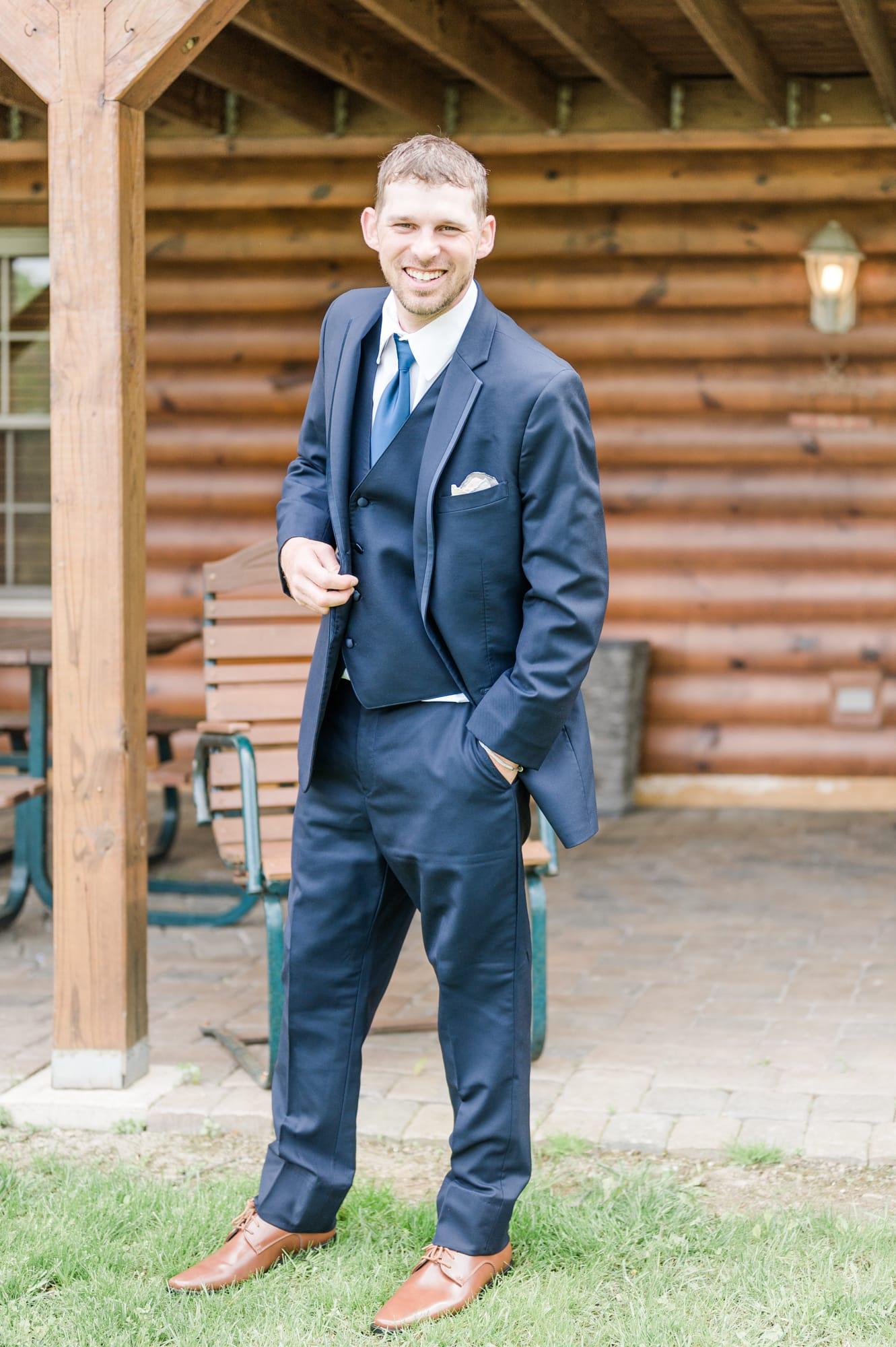 Groom portrait at Rolling Rails Lodge wedding
