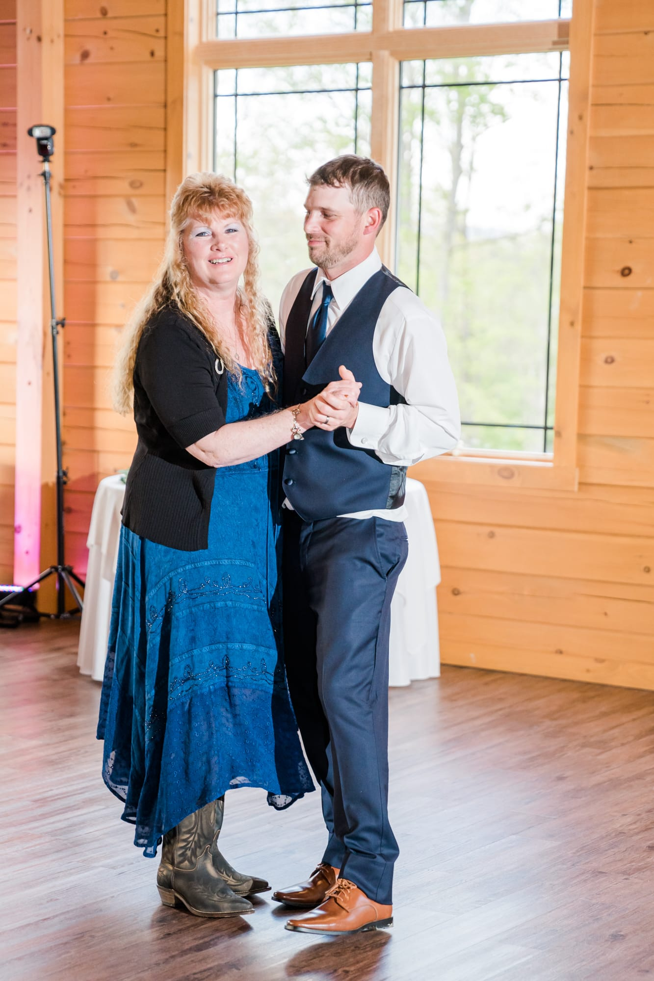 Groom and mother dance at Rolling Rails Lodge reception