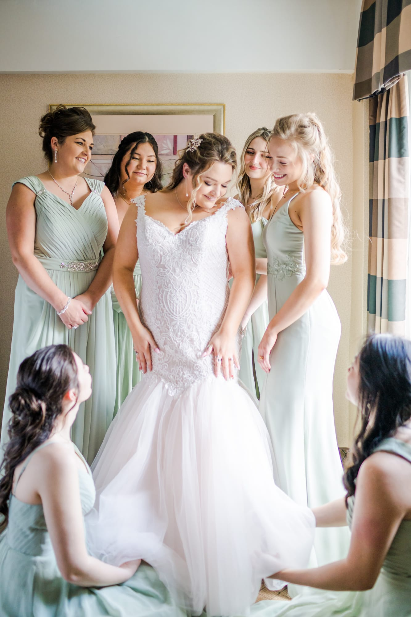 Central Pennsylvania PA summer wedding bridal party gushing fussing over the dress