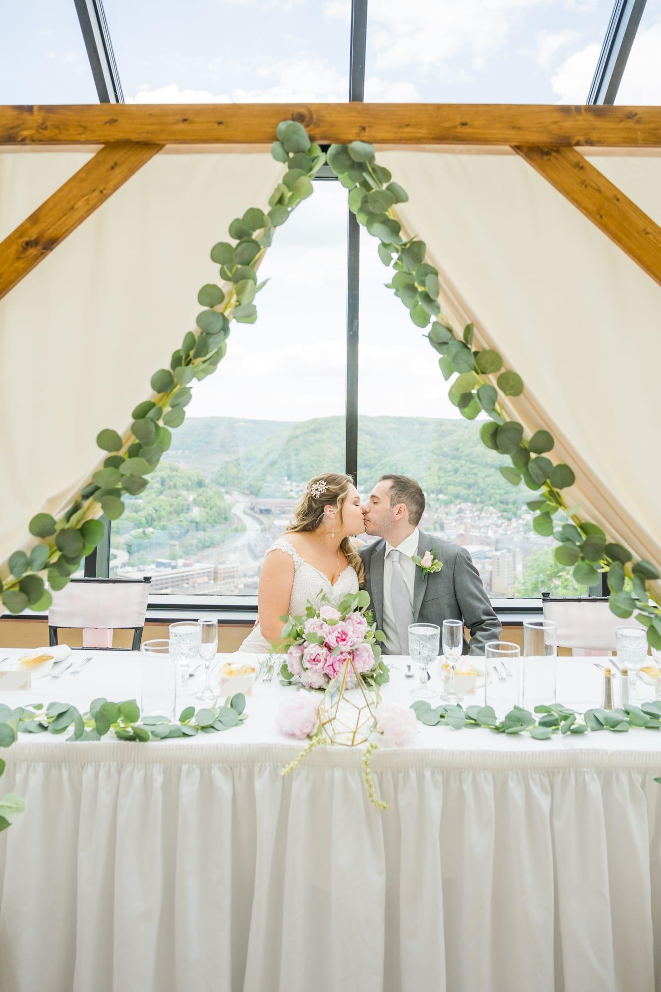 Central Pennsylvania PA summer wedding reception bride and groom kiss
