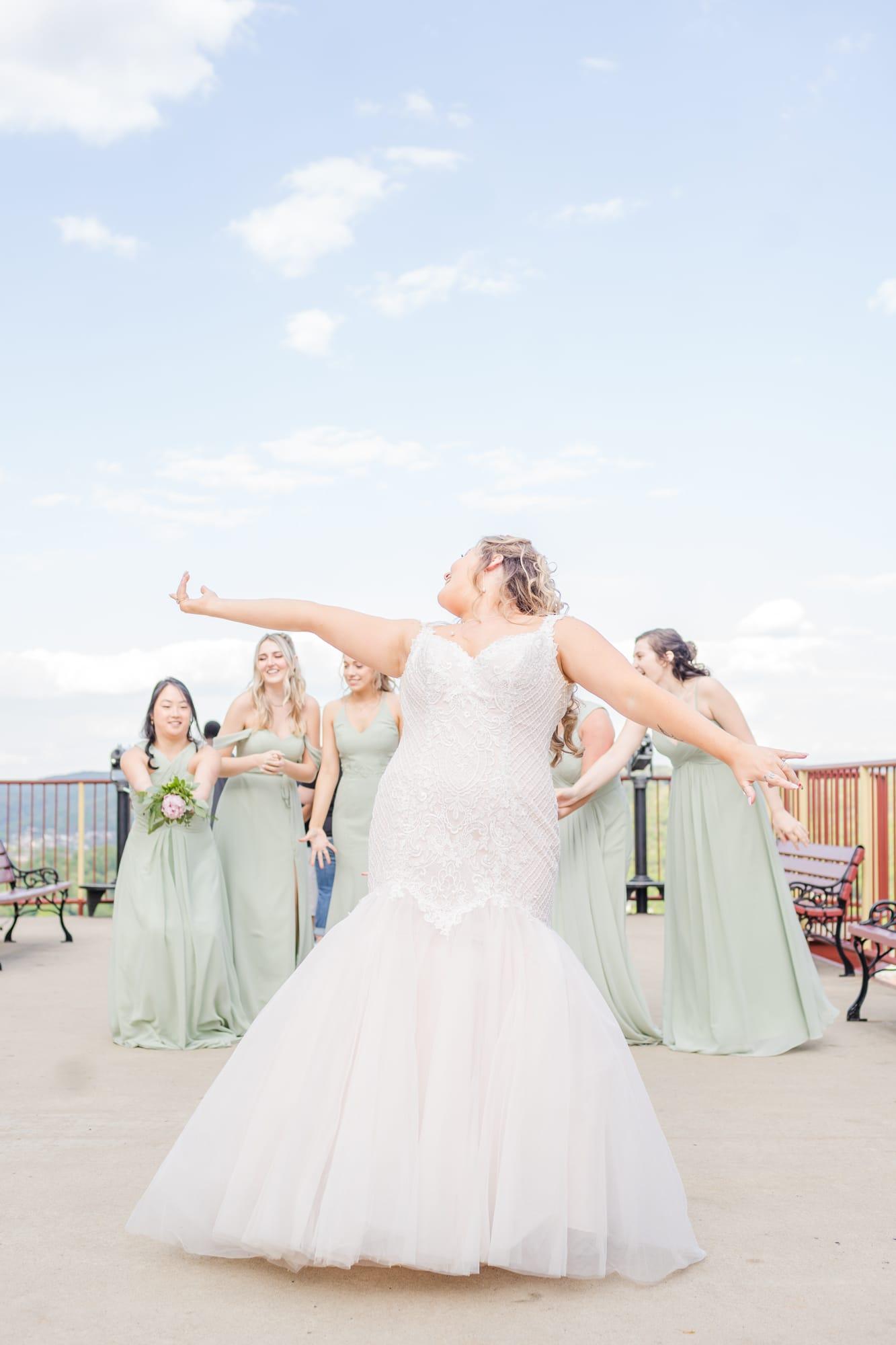 Central Pennsylvania PA summer wedding reception bouquet toss